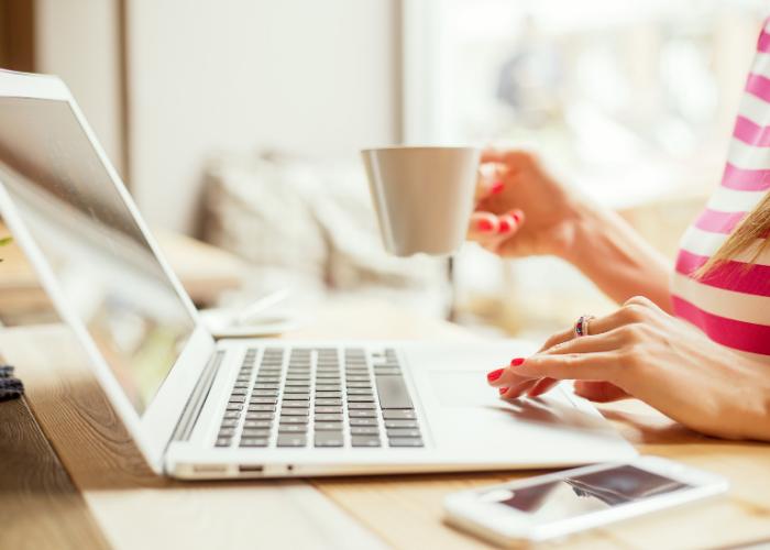 woman on laptop with mug